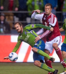 Seattle forward Roger Levesque (left, No. 24) and Portland midfielder Jack Jewsbury battle for the ball during the Portland at Seattle game on May 14, 2011, at CenturyLink Field. Photo courtesy of the Seattle Sounders.
