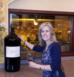 Sherry Monahan with Large Wine Bottle